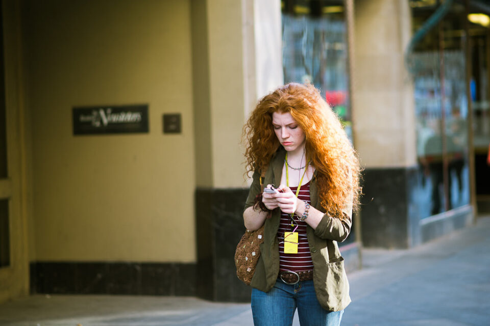 Girl walking with a phone