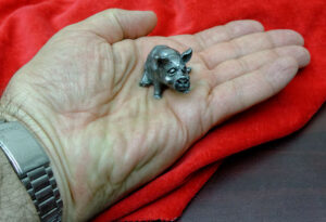 Pewter Pig in Palm of Hand