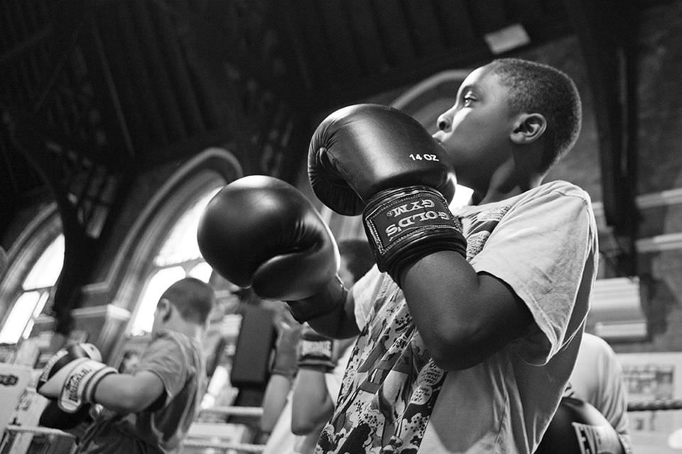 One of the youngest boys in the boxing club practising the figting routine.