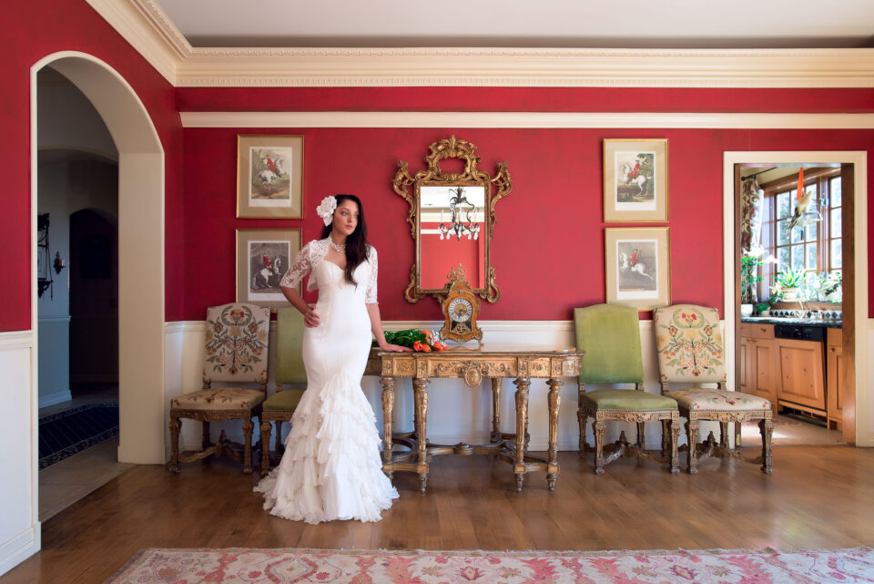 Taken with the Nikon D750. This wedding photo shows the bride posing for a portrait indoors.