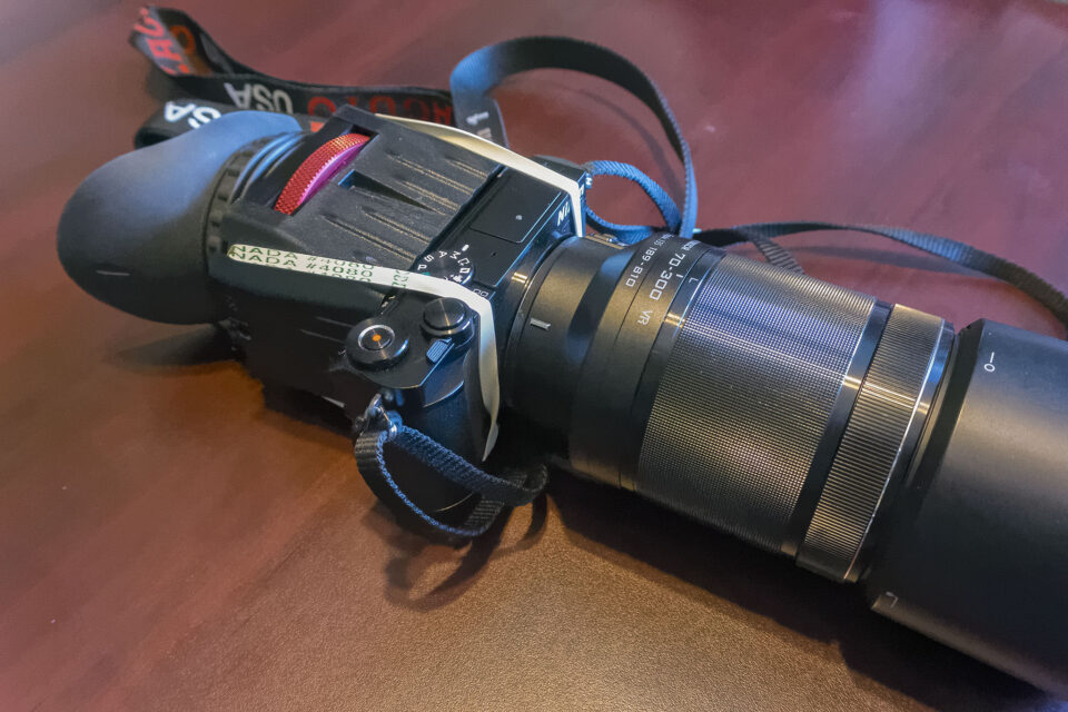 Zacuto Z-Finder attached to back of Nikon 1 J5 with elastic bands.