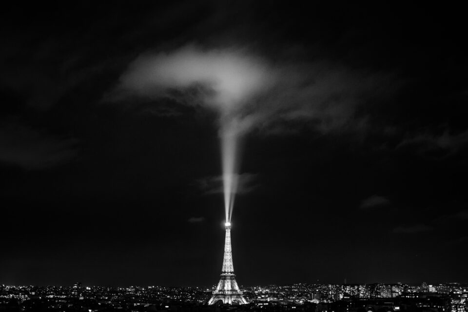 This photo shows the Eiffel Tower with a spotlight in the air. It took a lot of visualization to plan how this photo would look.