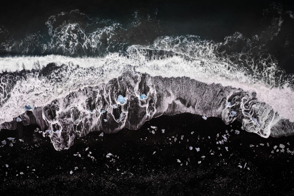 This aerial photograph of Jokulsarlon beach in Iceland was taken with the Nikon Coolpix A, a discontinued DX camera with a fixed 18.5mm prime lens.