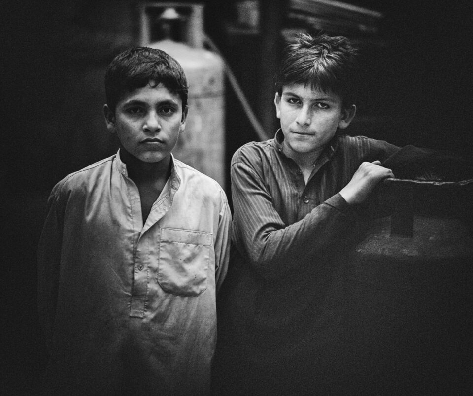 Young boys who work as waiters at a local chai khana (tea house) that services the working class.