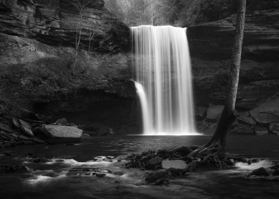 An black and white image of a waterfall