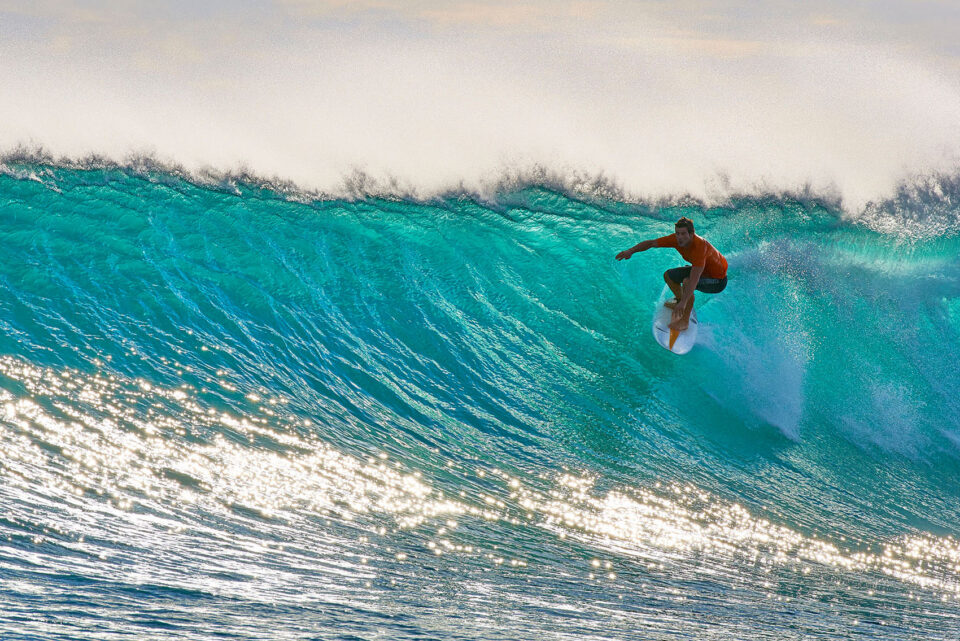 Surfer in Turquoise Wave