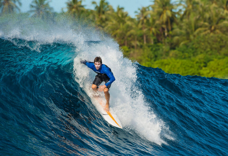 Surfing Waves in Indonesia