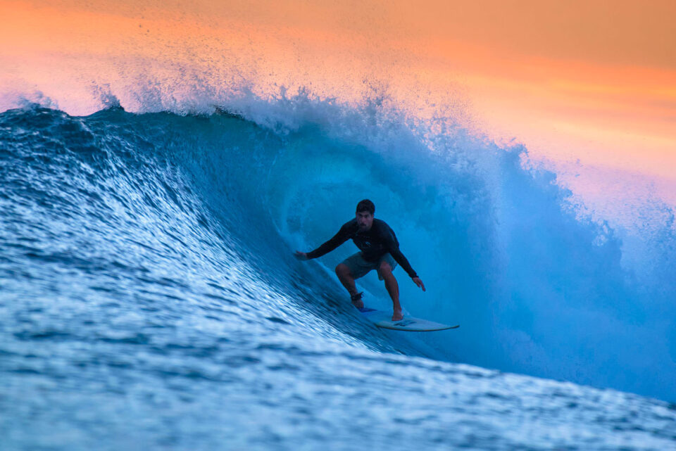 Surfing Waves at Sunset