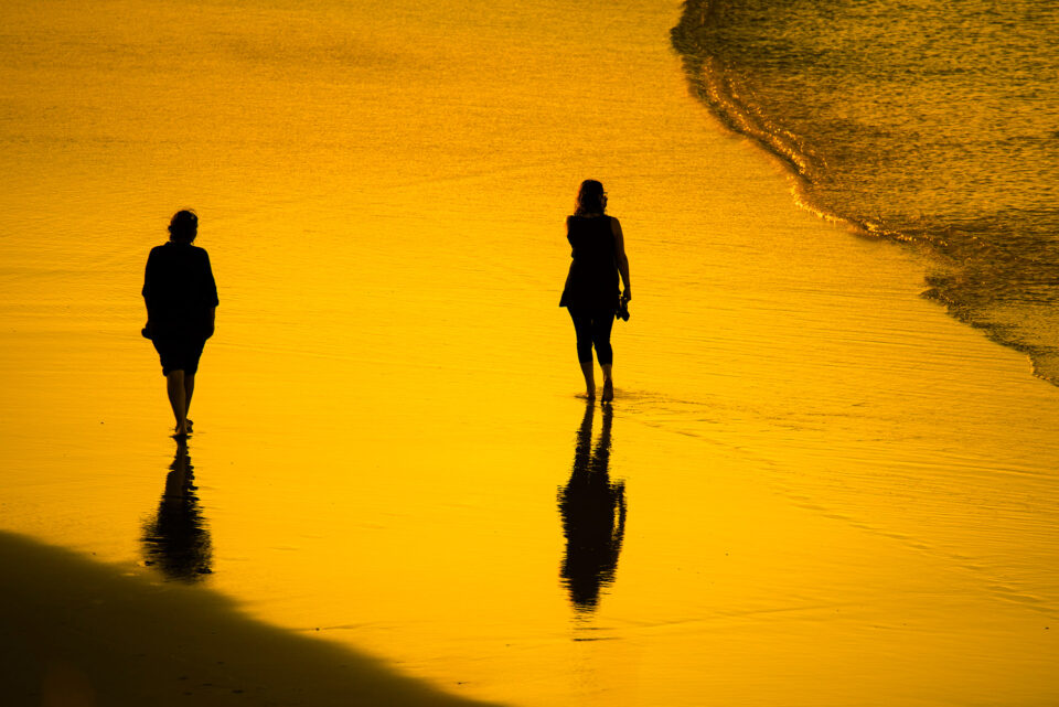 Walking-on-a-Beach-at-Sunset