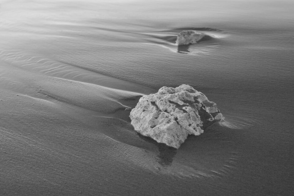 Rocks in the Sand Near the Lake
