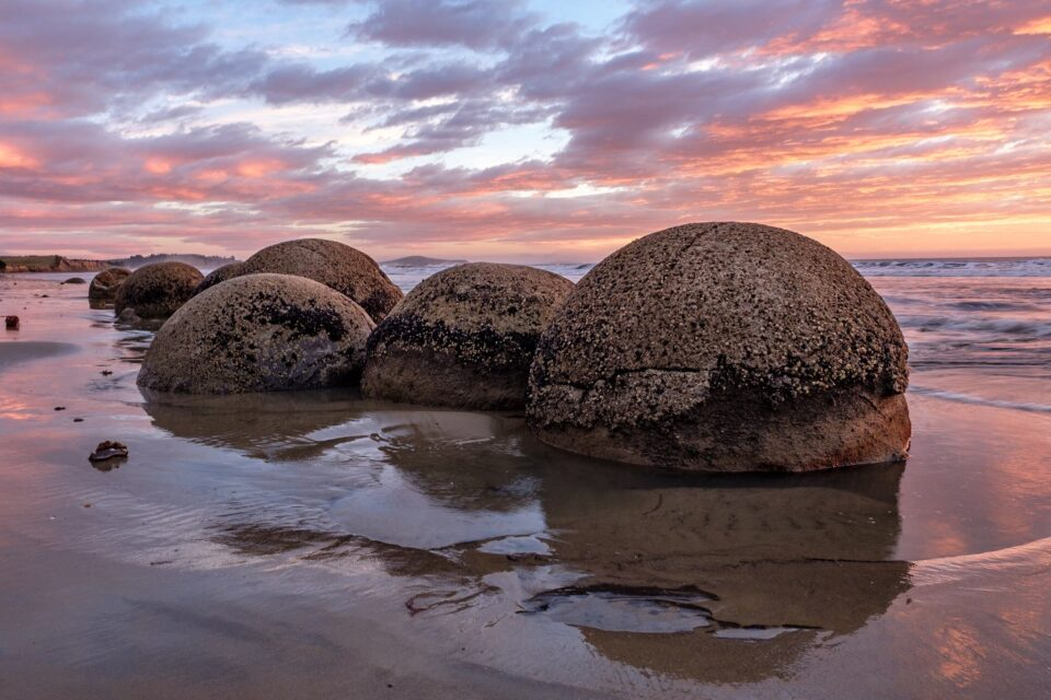 Moeraki Boulders, New Zealand. I intentionally processed the image to be bright and vibrant in colors.