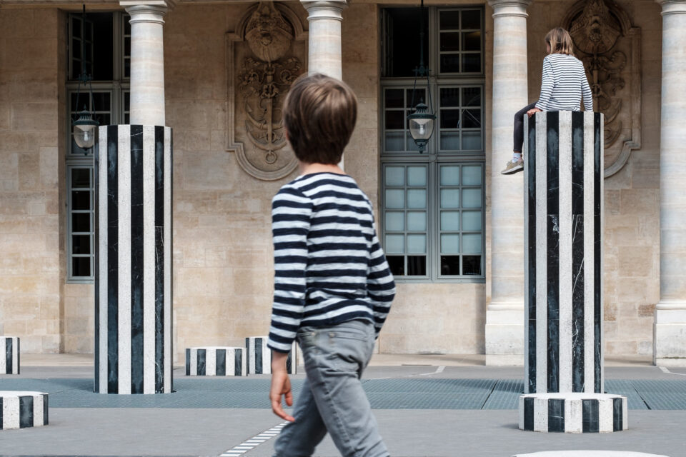 Good street photography tells a story. This photo's composition is filled with striped patterns that make it look more interesting.