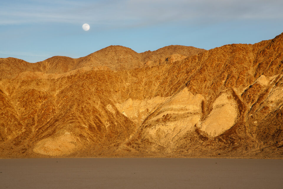 Image of the moon over mountains at sunset - how to photograph the moon