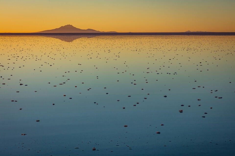 Salar de Uyuni is one of the most famous and beautiful areas of Bolivia for landscape photography. Here, sunset reflects colors in a flooded lake.
