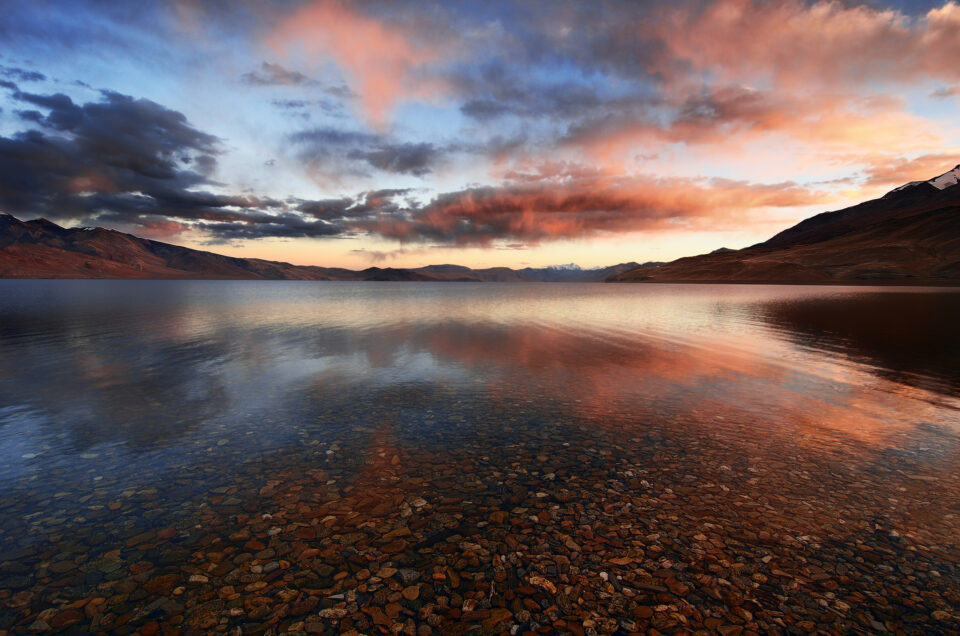 A reflection of a lake at sunset with colorful clouds - how to capture reflection photographs