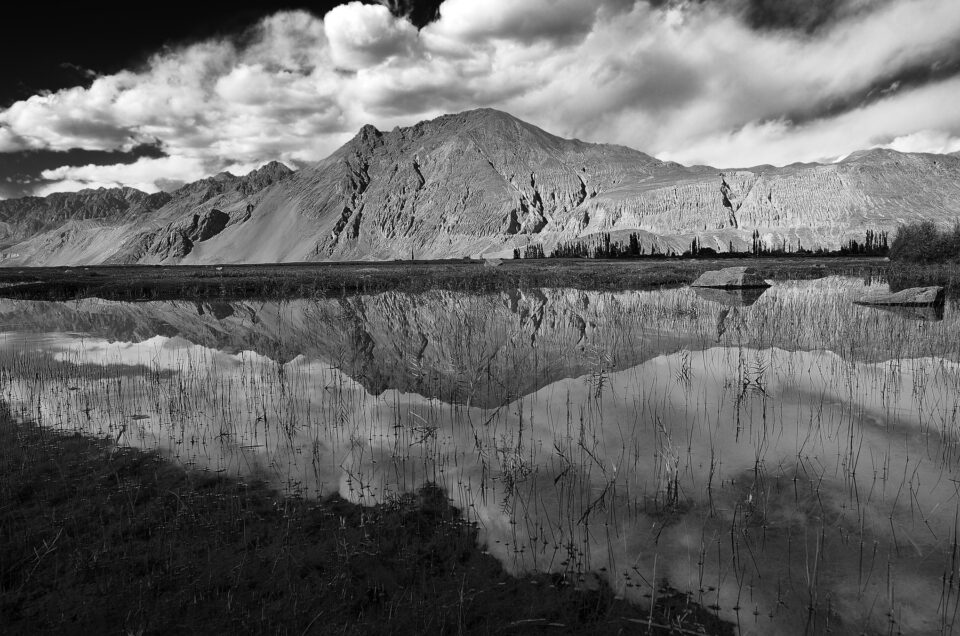 Black and white reflection shot with beautiful clouds