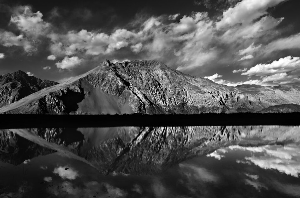 A black and white image of a lake reflection - how to take better reflection pictures