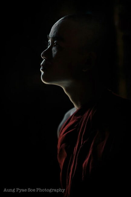Low light profile of a monk inside a Bagan temple