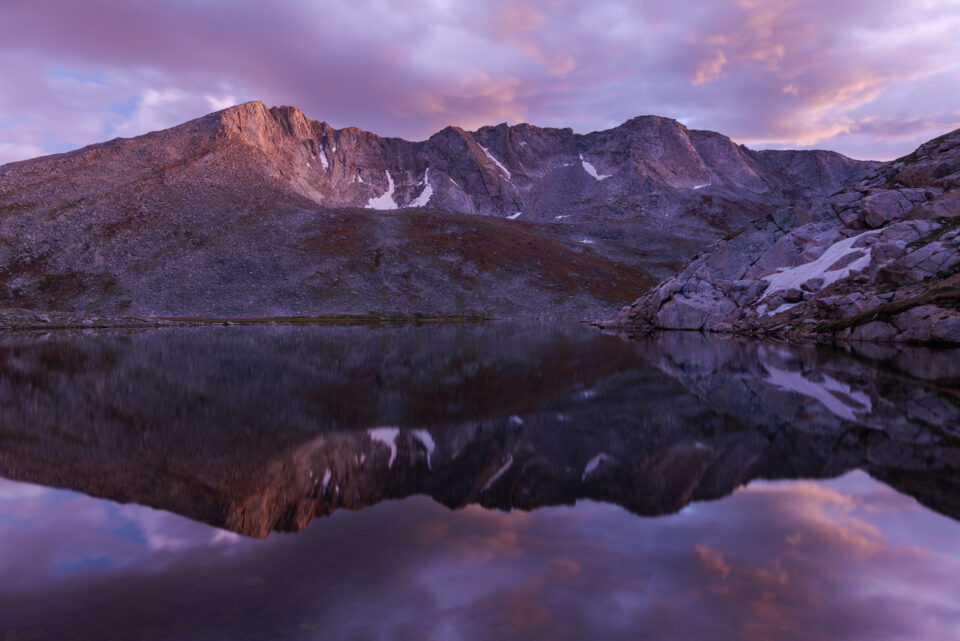 A landscape photo at sunset of Summit Lake, Mount Evans, Colorado.