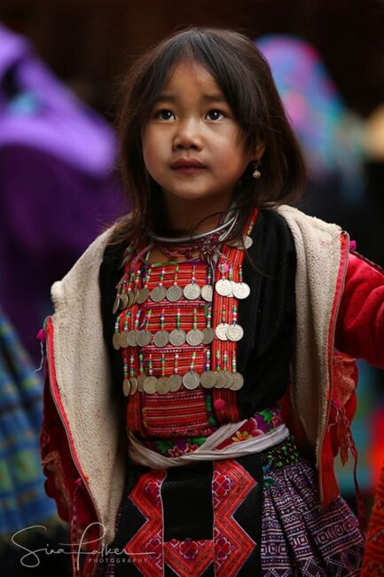 A 'Flower Hmong' girl at a mountain market in northern Vietnam. The mountains of Vietnam are among the last areas of Southeast Asia where traditional dress is still commonly worn among numerous different tribes. Many of them (not the Hmong) are considered 'vanishing'.