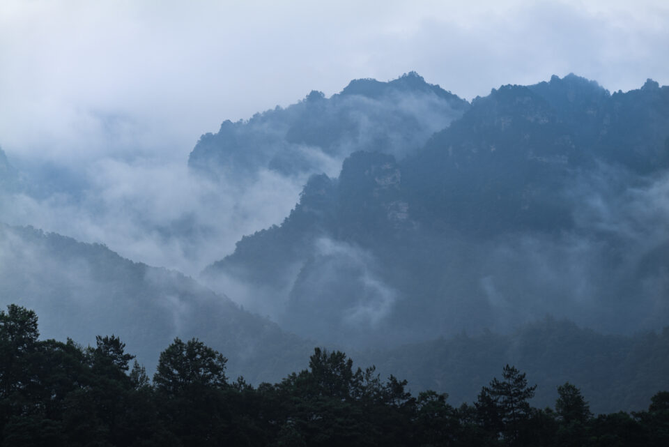 Mountains in China on a misty morning, taken from a distance with the Panasonic S1R.