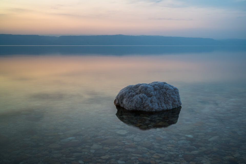 The subject here is a salt formation at sunset in the Dead Sea, Jordan.