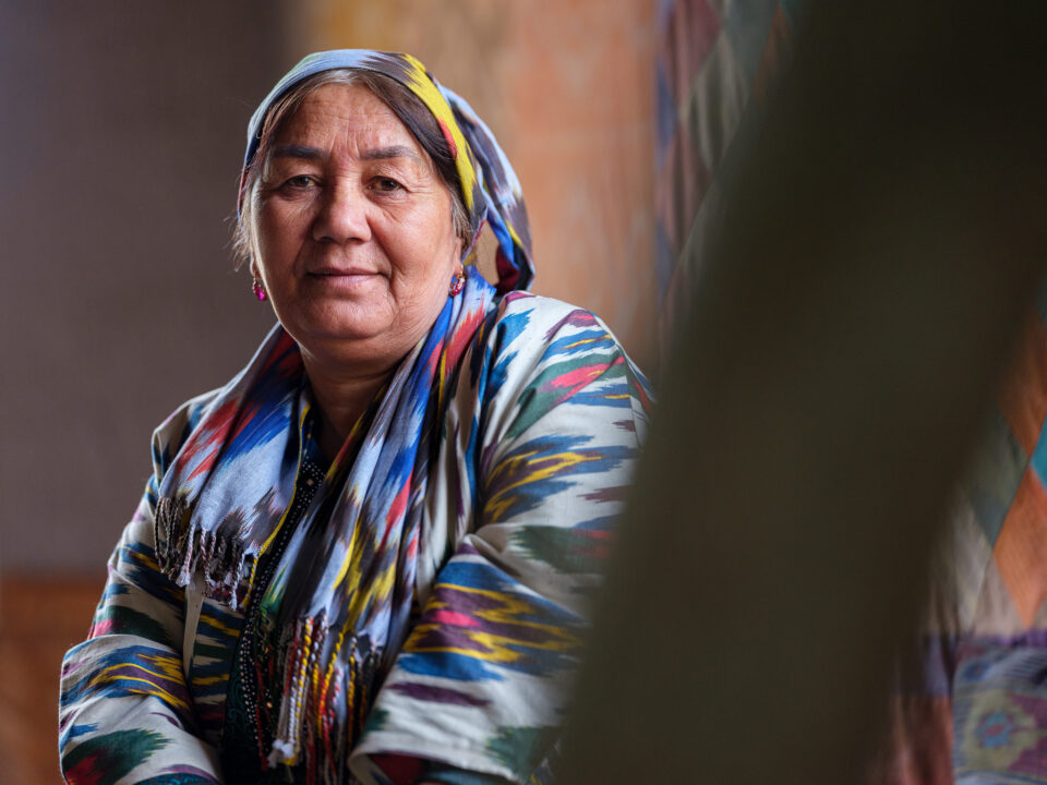 A woman from Ferghana Valley dressed in traditional Uzbek silk clothing