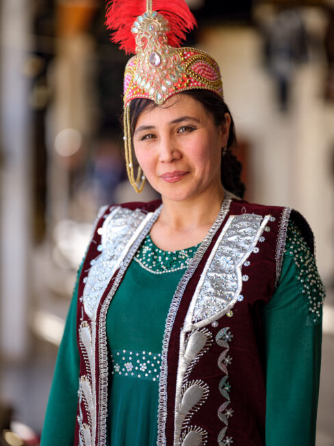 A portrait of a young woman wearing traditional Uzbek dress