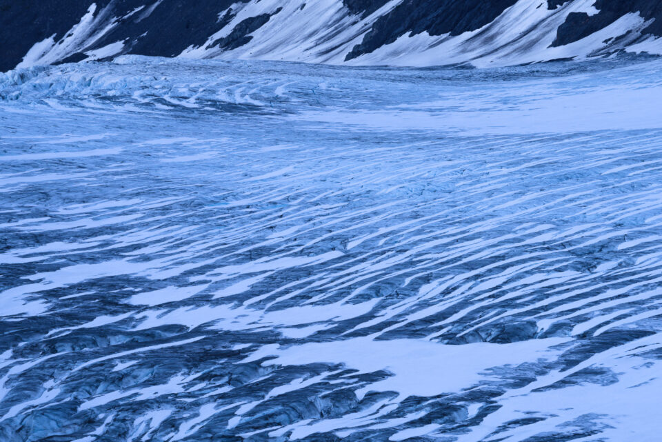 This abstract photo shows the patterns of lines on a glacier.