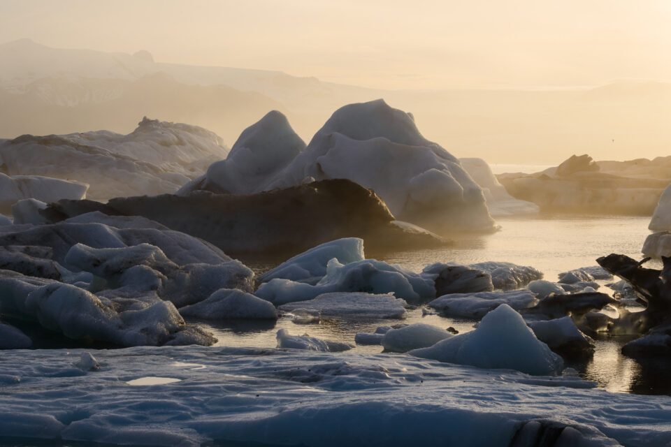 This photo of icebergs in Jokulsarlon lagoon has beautiful golden colors, because snow and ice tend to reflect the colors of the light around them.