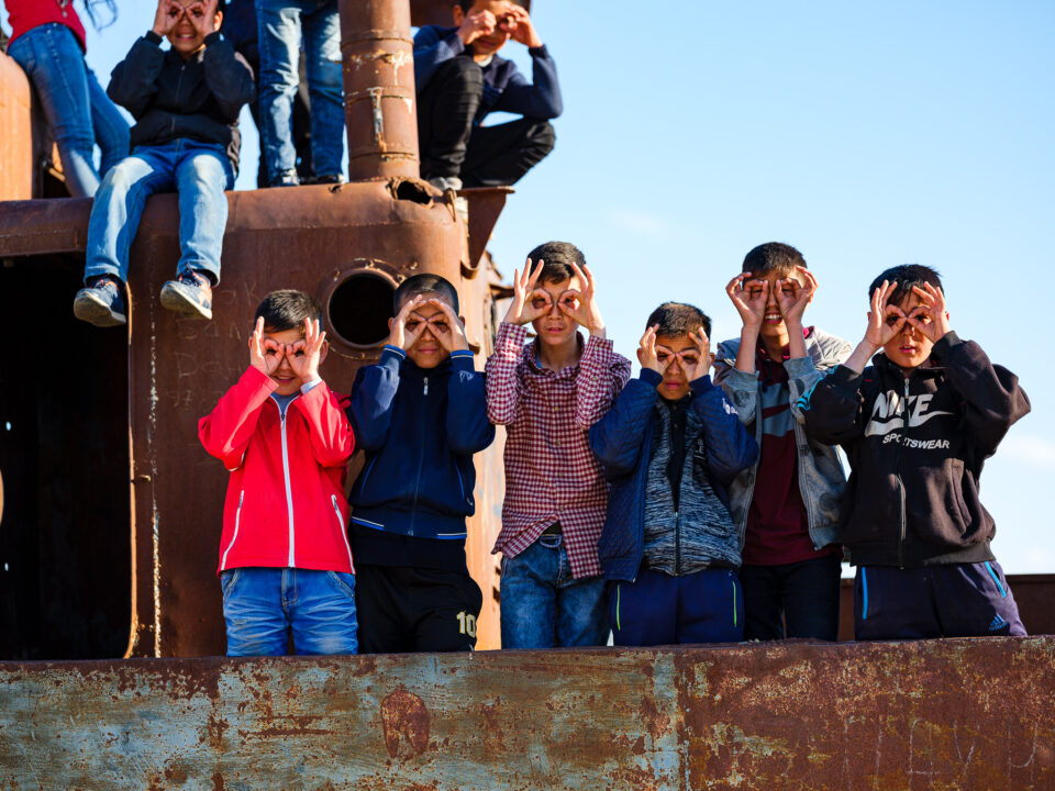 Karakalpak kids playing in ship graveyard