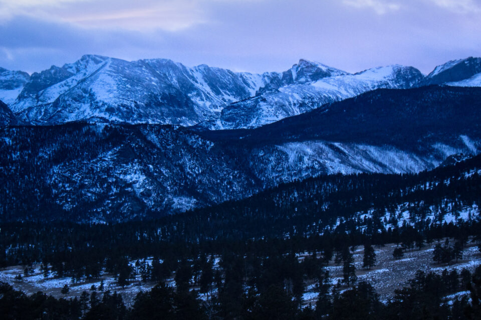 This landscape photo shows Rocky Mountain National Park in the snow during winter.