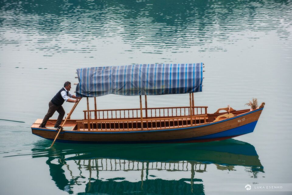 Going to work… Pletna boat rower at Lake Bled