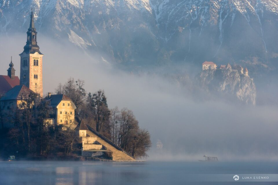 """First visitors arriving at Lake Bled island, photographed from the """"bench"""""""